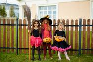 Three witches in Halloween attire looking at camera Stock Photos