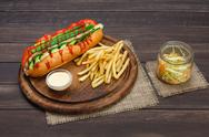 American food - classic hot dog with potato fries chips Stock Photos