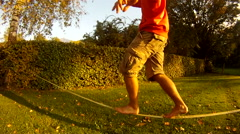 A young man slacklining on a sunny day. Stock Footage