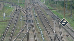 Empty railroad track with some train switches and electrical wires leading off Stock Footage