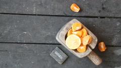 Natural food idea, slices of mandarin, lemon and text Stock Footage