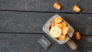 Natural food idea, slices of mandarin, lemon and text Stock Footage