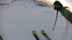 POV of young man skiing down a snow covered mountain at a European ski resort. Stock Footage