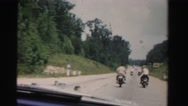 1955: driving windshield view motorcycles ride in tandem MIAMI, FLORIDA Stock Footage