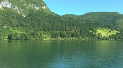 View on the Bohinj lake surrounding area from sailing boat Stock Footage