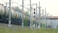 Freight train rides by rail away into the distance Stock Footage