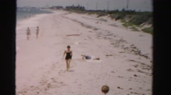 1955: women exploring beach view from above MIAMI, FLORIDA Stock Footage