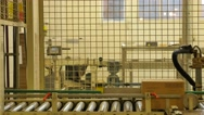 Cardboard boxes travelling along a conveyor belt in a rice factory – 4K Stock Footage