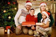 Family by Christmas tree Stock Photos
