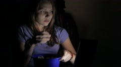 Girl watching horror movie on a laptop. 4K UHD Stock Footage