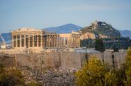 Acropolis in rays of sunset Stock Photos