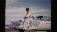 1955: woman walking and waving MIAMI, FLORIDA Stock Footage