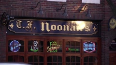 Exterior Noonan's Irish pub in NYC suburb Stock Footage