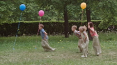 Funny Kids Jumping in Sacks Stock Footage