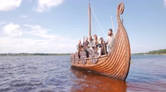 Mad vikings on the Drakkar on the river shore Stock Footage