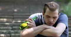 Young Teen Boy Drink Beer Bottle Sad Man Sleep Alcohol Abuse Problem Park Scene Stock Footage