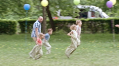Competing in Sack Race with Dad Stock Footage