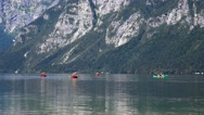 Unrecognizable people rowing on Bohinj lake in Slovenia Stock Footage