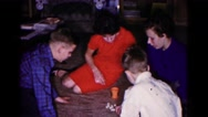 1961: family sitting on carpet playing games HAGERSTOWN, MARYLAND Stock Footage