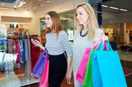 Friendly girls spending time and money by shopping Stock Photos