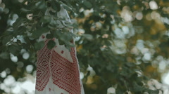 Embroidered towels hanging on a tree branch Stock Footage
