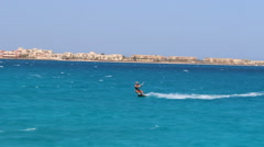 A young woman kite surfing in Egypt. Stock Footage