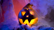 The head of a pumpkin in a sinister and spectacular illumination, pumpkin Stock Footage