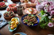 Fresh berries, apricots and other food on served table Stock Photos