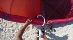 A young man kite surfer pumping up his kite on a beach in Egypt. Stock Footage