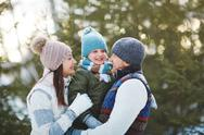 Caucasian family enjoying weekend on winter day Stock Photos