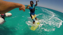 A young man kite surfer pounding fists with friend. Stock Footage