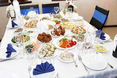 Served banquet table with dishes in restaurant Stock Photos