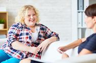 Happy woman with overweight looking at psychologist Stock Photos