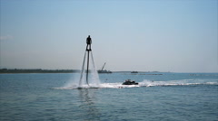 Silhouette of a Man Having Fun on Flyboard in the Sea. Stock Footage