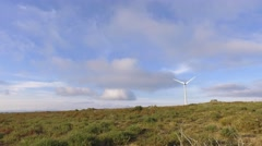 Eolic turbine wind renewable energy farm on top of mountain 4k Stock Footage