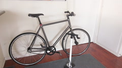 A bike leaning against the wall of an apartment. Stock Footage