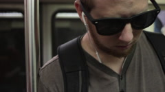 A young man riding on the public metro train with his bike. Stock Footage