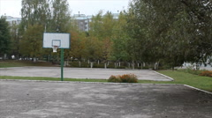 Basketball court in the school yard Stock Footage
