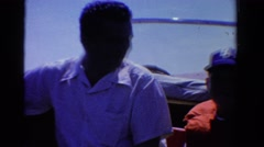 1958: dad son and uncle on boating trip wearing lifejackets MINNESOTA Stock Footage