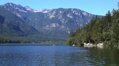 Unrecognizable couple kayaking on Bohinj lake in Slovenia Stock Footage