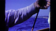 1958: an old man with good catch of fish on his fishing gear MINNESOTA Stock Footage