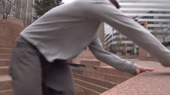 A young man freerunner doing parkour on sculptors in city park. Stock Footage