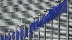 Flags against the Berlaymont building in Brussels Stock Footage