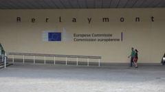 People walk near the Berlaymont building in Brussels Stock Footage