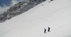 Mountaineers Descending Glacier. Stock Footage
