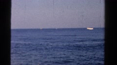 1958: middle aged man fishing boat bright blue sunny day MINNESOTA Stock Footage