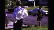 1958: family watches baby playing in the driveway MINNESOTA Stock Footage
