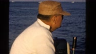 1958: old man and the sea patiently fishing the open ocean MINNESOTA Stock Footage