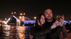 Happy couple in love taking selfie. A movable Palace Bridge St. Petersburg at Stock Footage