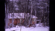 1958: winter snow wooded cabin quaint style wonderful home. MINNESOTA Stock Footage